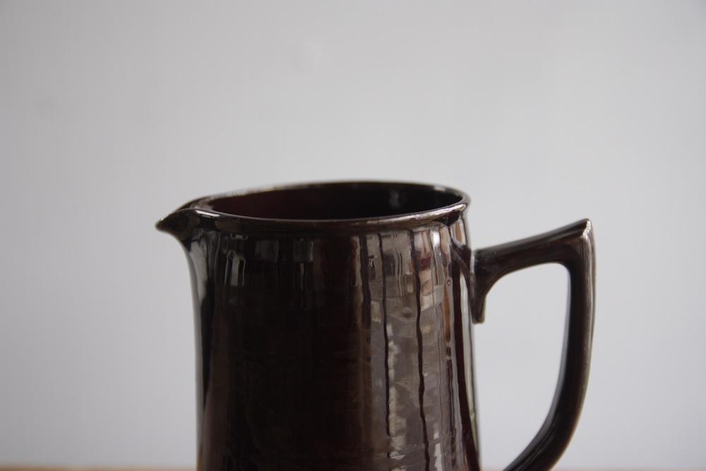 brown ceramic jug pitcher